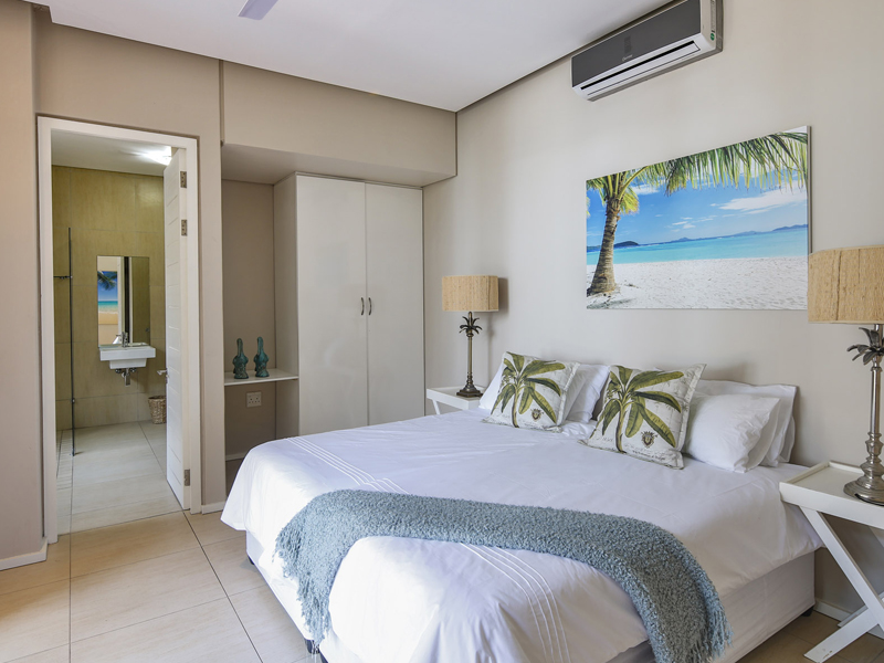 Bedroom with seaview at Sovereign Sands the luxurious beach Holiday Villa on the North Coast. This 8 sleeper is the epitome of self-catering excellence, a perfect holiday home.